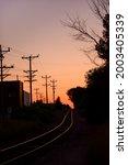 Railroad Tracks And Silhouette...