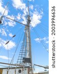Wooden Mast And Ropes Of...