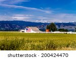 White Barn With American Flag...