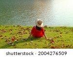 Woman In Straw Hat Relaxing...