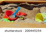 Pit Sand With Plastic Toys