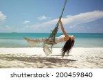 Beautiful Woman On A Swing On...