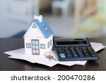 toy house and calculator on... | Shutterstock . vector #200470286