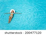 Girl With Hat Swimming In...