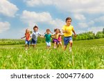 running kids in green field... | Shutterstock . vector #200477600