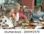 elder couple eating pizza with... | Shutterstock . vector #200492570