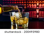 barman pouring whiskey in a... | Shutterstock . vector #200493980