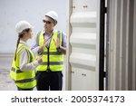 caucasian logistic worker open... | Shutterstock . vector #2005374173