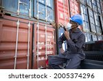 black inspector with protect... | Shutterstock . vector #2005374296