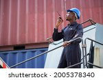 black container worker hold... | Shutterstock . vector #2005378340