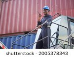 black container worker hold... | Shutterstock . vector #2005378343