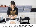 asian woman getting her hair... | Shutterstock . vector #2005439846
