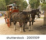 An old fashioned horse and carriage in Colonial Williamsburg. - stock photo