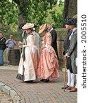 Actors in costume at colonial Williamsburg Virginia. - stock photo