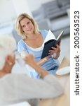 homecarer reading book to... | Shutterstock . vector #200563523
