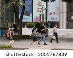 Small photo of People wearing masks walk in downtown of Seoul, South Korea, July 9, 2021. South Korea will place the greater Seoul area under the toughest social distancing rules of Level 4 from July 12.