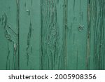 Old green wooden wall with...