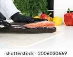 Chef Cuts Raw Trout On A White...