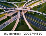Highway Interchange loops and turnarounds , travel destination and following the busy highway system aerial drone look looking down from above curved raised roadways in Austin Texas USA