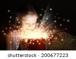 little cute girl opening... | Shutterstock . vector #200677223