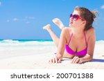 young woman in bikini lying on... | Shutterstock . vector #200701388