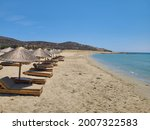 Small photo of whir sand beach with chairs and umbrellas