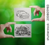 hand holding hand drawn house... | Shutterstock . vector #200805983