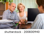 Small photo of aged couple of pensioners talking with employee at office
