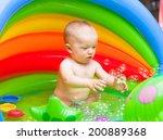 cute baby splashing in a... | Shutterstock . vector #200889368