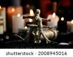 Voodoo Dolls On Table In Dark...