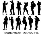 man and women with a camera on... | Shutterstock .eps vector #200922446