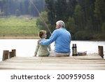 senior man fishing with grandson | Shutterstock . vector #200959058