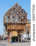 Small photo of LONDON-MAY 18, 2014: timber frame sculpture. It is made from 17 cubic metres of larch and marks the place where the Aldgate once stood, that was the easternmost gate of the old wall of City of London