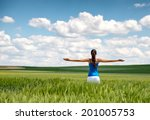 image of a girl in a wheat... | Shutterstock . vector #201005753