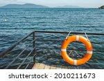 Bright Orange Lifebuoy On Pier  ...