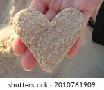 A Hand Holding A Heart Made Of...