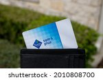 Small photo of San Antonio, TX USA - Mar. 03, 2020: A hand and wallet holds a Sam's Club Plus Member membership card, which gives users access to Sam's Club warehouse shopping, cheap food courts, and chicken