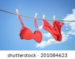 Stock photo underwear hanging on clothesline outside 201084623