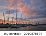 Boats In A Harbor On A Dock In...