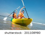 cheerful couple paddling in... | Shutterstock . vector #201108980