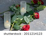 Red Flowers And Tea Lights At...