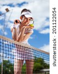 female playing tennis on court | Shutterstock . vector #201122054