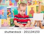 cute little boy enjoys drawing... | Shutterstock . vector #201134153
