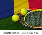 A Tennis Racquet With Tennis...