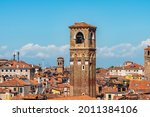 View of the rooftops of the island of Venice in Italy, the domes and church bell towers.