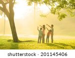 family having fun pointing to... | Shutterstock . vector #201145406