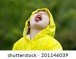 Young Girl Playing In Rain