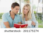 hip young couple having coffee... | Shutterstock . vector #201175274