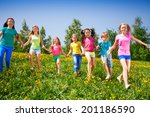 happy children run and hold... | Shutterstock . vector #201186590