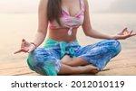 Yoga On The Beach. Happy Asian...